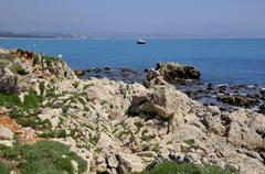 Rocky coastline of Antibes in France - stock photo
