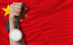 silver medal for sport and  national flag of china - stock photo