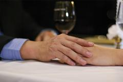 Close up mate lover hand on table in luxury restaurant Stock Photos