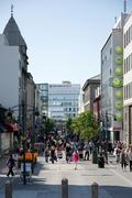 busy street in reykjavik on a sunny day - stock photo