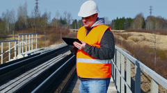 Railroad worker with tablet PC on railway Stock Footage