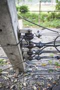 a electric and telephone pole leans after damage from a storm. - stock photo