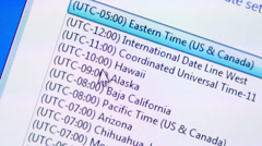 Selecting time zone on a computer Stock Footage