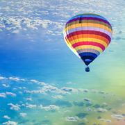 hot air balloon on sea with cloud - stock photo