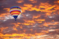 Balloon on sunset / sunrise with clouds, light rays and other atmospheric effect Stock Photos