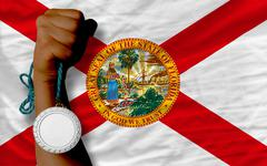 silver medal for sport and  flag of american state of florida - stock photo