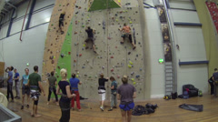 People are climbing in hall - stock footage