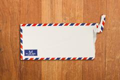 Envelope by air mail isolated on wood Stock Photos