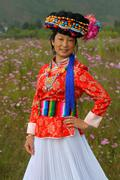 Portrait of Mosuo minority nationality girl in beautiful dress Stock Photos