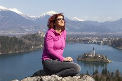 Cute woman sunbathing by the Lake Bled - stock photo
