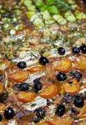 Tasty vegetarian pizza with sardines close-up, selective focus Stock Photos