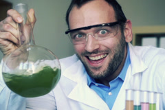 Crazy, mad scientist laughing in laboratory, super slow motion, shot at 240 NTSC Stock Footage