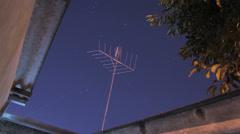 Night sky time lapse -  TV antenna - Timelapse Stock Footage