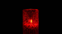 Red candle holder and flame Stock Footage