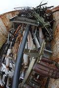 pipes and tubes, ferrous scrap iron in a container - stock photo
