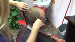 Barber woman hands cut short customer man hairs in salon Stock Footage