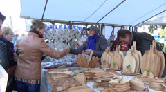 Crafts market buyers looking around and buy the goods Stock Footage