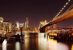 Nice view on restaurants under the Brooklyn Bridge - stock photo
