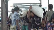 Stock Video Footage of ASIAN PORT & JETTY:  BURMA - POV down gangway as workers carry goods