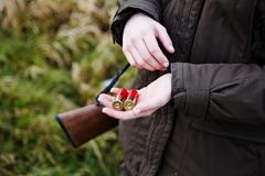 A female hunter holds munitions Stock Photos