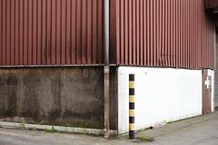 A safeguard at the corner of an industrial building. - stock photo