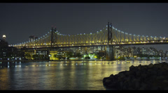 59th St Queensborough Bridge at night in New York City Stock Footage