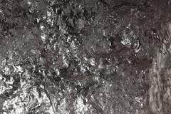 Musta bitumista kivihiiltä, hiilen hippu tausta Kuvituskuvat