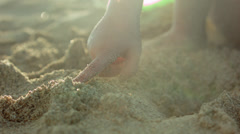 Extreme Close Up Of Little Girl's Hand Exploring, Digging In The Sand - stock footage