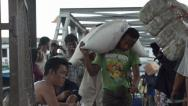 Stock Video Footage of ASIAN PORT & JETTY:  BURMA - Medium shot porters carry goods towards camera