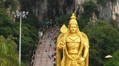 Kuala Lumpur Limestone Cave Batu Caves 42.7 meter Murugan Statue Malaysia Asia Stock Footage