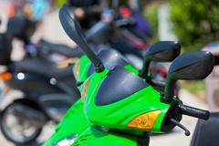 green scooter detail - stock photo