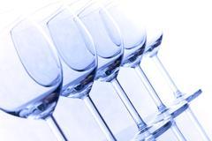couple of empty wineglasses on white background - stock photo
