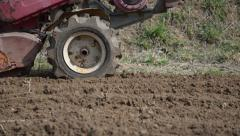 Cultivator plowing garden Stock Footage