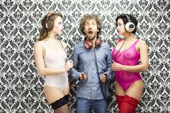 man with 2 disco dancers - stock photo