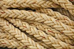 Nautical knots. big marine vintage sea ropes in heap background Stock Photos