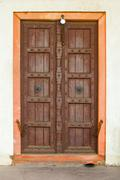 Old wooden door on a building facade. india, agra Stock Photos