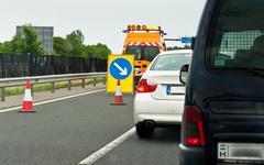Traffic jam on highway with blockade Stock Photos