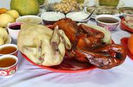 Stock Photo of boiled chicken and stewed duck and various food for chinese new year