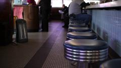 Classic Diner | Chrome stools with patrons - stock footage