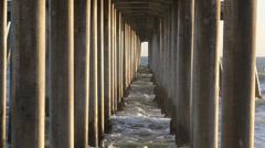 Ocean Spray on Pier Pylon Rows - stock footage