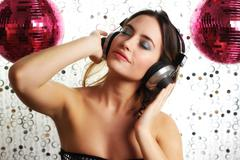 Beautiful dancing woman with headphones Stock Photos