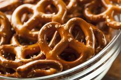 Organic brown mini pretzels with salt Stock Photos