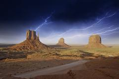 Storm over Monument Valley Rocks with lightning - stock photo