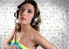 Beautiful woman with headphones Stock Photos