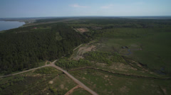 Forest, river and oil rigs from helicopter 01 Stock Footage