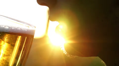 Man drinking beer on sunny day Stock Footage