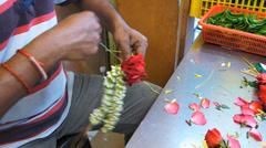 Kuala Lumpur man making Hindu Hindus flower ring Malaysia Asia Stock Footage