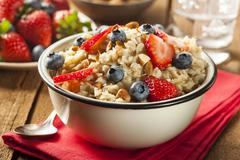 healthy homemade oatmeal with berries - stock photo