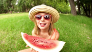 Stock Video Footage of Girl eating slice of watermelon in slow motion