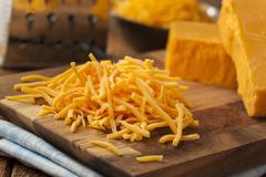 Organic shredded sharp cheddar cheese Stock Photos